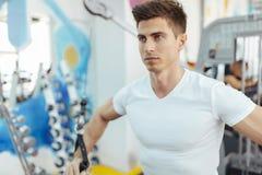 Handsome man training in clean modern gym stock photos
