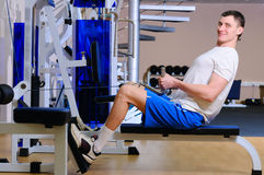 Handsome man is training in gym Stock Photography