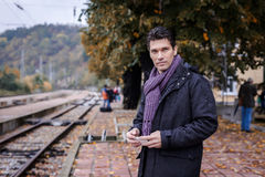 Handsome man traveller waiting for the train Royalty Free Stock Photos