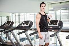 handsome man on treadmill drinking water Royalty Free Stock Photo