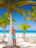 Handsome man on tropical resort Stock Images