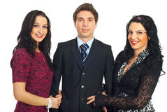 Handsome man with two elegant women Stock Image