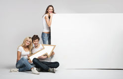 Handsome man with two girls and arrow Royalty Free Stock Photos