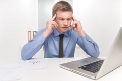 Handsome man under stress, fatigue and headache. Royalty Free Stock Image