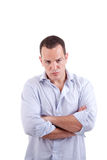 Handsome man upset with his arms crossed Royalty Free Stock Photography