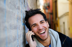 Handsome man in urban background talking on phone Stock Image