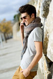 Handsome man in urban background talking on phone Stock Photos