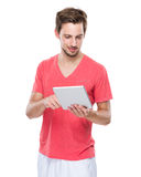 Handsome man use of digital tablet Royalty Free Stock Image
