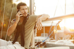 Handsome man using cellphone on sailing boat Stock Photo