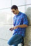 Handsome man using digital tablet Stock Image