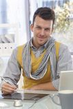 Handsome man using drawing table smiling Stock Photography