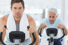 Handsome man using exercise bike Royalty Free Stock Images