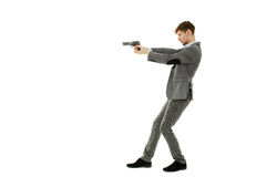 Handsome man using a gun Royalty Free Stock Photos