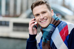 Handsome man using his mobile at outdoors Stock Photos