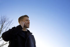 Handsome man using his mobile phone Stock Photo