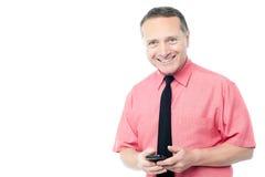 Handsome man using his smartphone Stock Photo