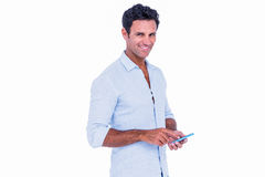 Handsome man using his smartphone Royalty Free Stock Image