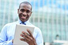 Handsome man using his tablet computer Royalty Free Stock Images