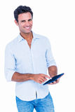 Handsome man using his tablet computer Stock Photography