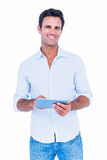 Handsome man using his tablet computer Stock Image