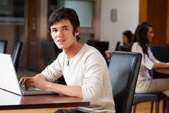 Handsome man using a laptop Royalty Free Stock Image