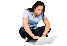 Handsome man using a laptop Stock Photo