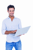 Handsome man using laptop computer Stock Photography