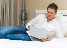 Handsome man using laptop. Royalty Free Stock Photo