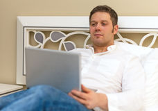 Handsome man using laptop. Royalty Free Stock Photography