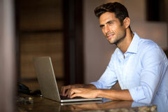Handsome man using laptop Stock Images