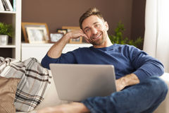 Handsome man using laptop Royalty Free Stock Photos