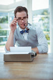 Handsome man using old fashioned typewriter Royalty Free Stock Images