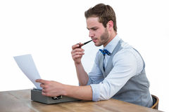 Handsome man using old fashioned typewriter Royalty Free Stock Photos