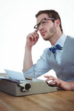 Handsome man using old fashioned typewriter Stock Images