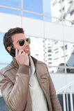 Handsome man using a phone Royalty Free Stock Photos