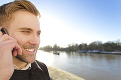 Handsome man using a phone on a sunny day Royalty Free Stock Photos