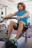 Handsome man using resistance band in gym Royalty Free Stock Photos