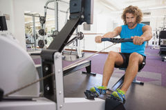 Handsome man using resistance band in gym Stock Photo