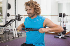 Handsome man using resistance band in gym Royalty Free Stock Photo