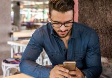 Handsome man using smartphone Royalty Free Stock Photography