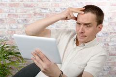 Handsome man using tablet computer Stock Image
