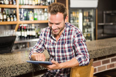 Handsome man using tablet computer Royalty Free Stock Images