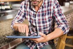 Handsome man using tablet computer Stock Photography