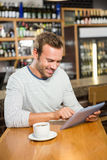 Handsome man using tablet computer Stock Photo