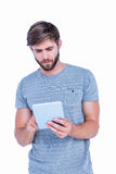 Handsome man using tablet computer Stock Images