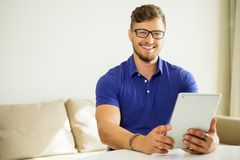 Handsome man using tablet pc Stock Photos