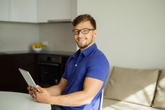 Handsome man using tablet pc Stock Images