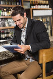 Handsome man using tablet Royalty Free Stock Photos