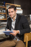 Handsome man using tablet Stock Image