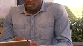 Handsome man using tablet stock video
